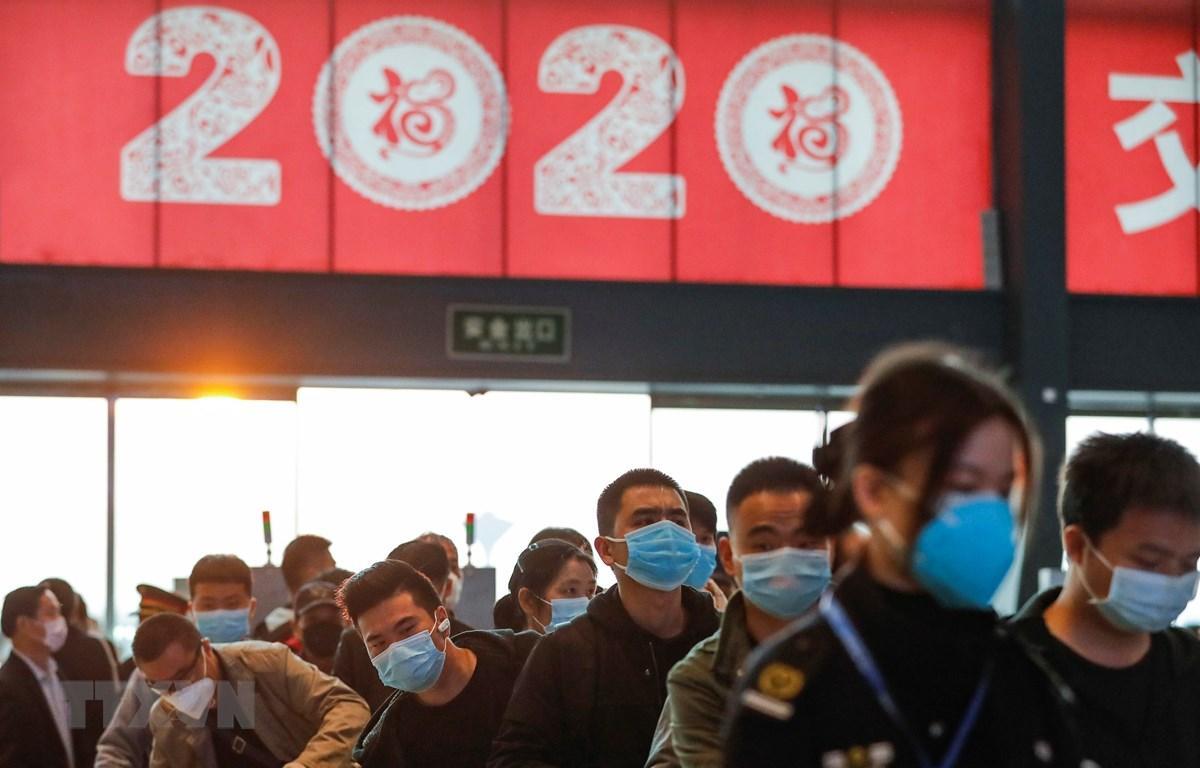 Trung Quốc tăng cường quản lý y tế những người rời khỏi Vũ Hán Ảnh 1