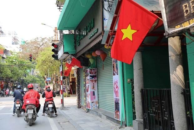 Hà Nội: Cửa hàng kinh doanh hàng không thiết yếu chỉ mở cửa sau 9 giờ Ảnh 1