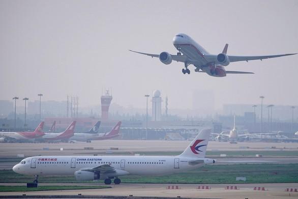 Trung Quốc 'xuống nước' nhượng bộ, Mỹ nới lỏng lệnh cấm bay Ảnh 1