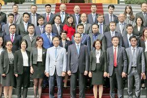 Chủ tịch nước Trần Đại Quang gặp mặt các Tham tán thương mại và Trưởng bộ phận Thương vụ Việt Nam ở nước ngoài