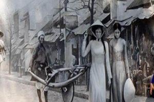 Ấm trời, các mẹ các chị nô nức ra phố bích họa chụp ảnh Hà Nội xưa