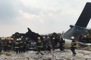 Hiện trường bốc khói vụ máy bay chở 71 người rơi ở Nepal