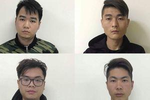 Tội phạm người Trung Quốc dùng thẻ ATM giả để rút tiền tại Việt Nam.