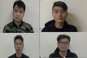 Khởi tố 4 người Trung Quốc dùng thẻ ATM giả rút tiền