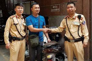 Đại úy CSGT quật ngã tên trộm xe SH trên phố Hà Nội