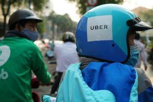 Không thể võ đoán thương vụ Grab mua lại Uber