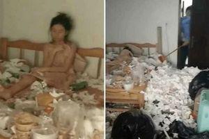 Quá đau khổ vì thất tình, cô gái trẻ nằm khóc trong căn phòng đầy rác thải hôi thối
