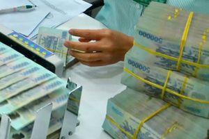 Tài chính 24h: Hạ giá VND để hỗ trợ xuất khẩu?