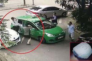 Khởi tố chủ xe Mercedes cầm gạch đánh tài xế taxi phun máu ở Hà Nội