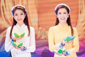 Hoa hậu Phí Thùy Linh diễn áo dài cho bạn thân Ngọc Hân