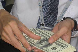 Giá vốn tiền đồng tăng giúp 'kìm chân' tỷ giá