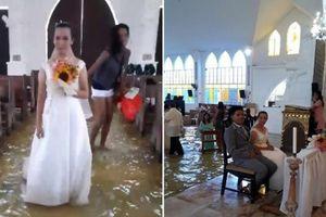 Cô dâu chú rể lội nước trong đám cưới