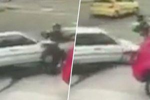 Clip: Tài xế ô tô tông thẳng vào kẻ cướp, giải cứu người đi đường
