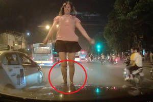 Lộ nguyên nhân cô gái mặc váy ngắn 'quẩy' tưng bừng trên nóc xe container