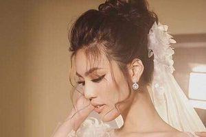 Trước ngày lên xe hoa, hé lộ hình ảnh Lan Khuê e ấp trong chiếc váy cô dâu