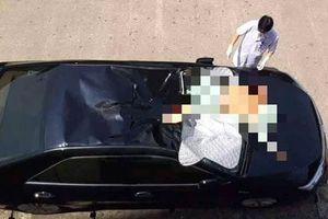 Nam bệnh nhân nhảy lầu tự tử rơi trúng nóc ô tô
