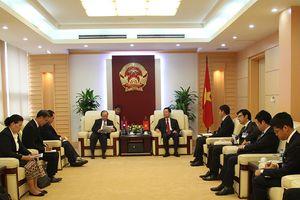 Quyền Bộ trưởng Nguyễn Mạnh Hùng tiếp Bộ trưởng Bộ Thông tin, Văn hóa và Du lịch Lào