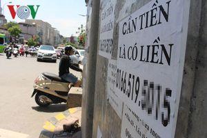 Tờ rơi, quảng cáo nham nhở bôi bẩn đường phố Hà Nội