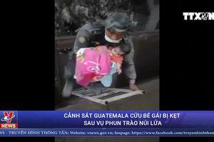 Bé gái bị kẹt sau vụ phun trào núi lửa được cảnh sát Guatemala cứu