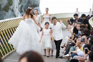 Minh Tú mặc váy cưới đính kết từ 50.000 cánh hoa, biểu diễn trên... mây