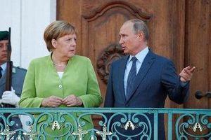 Putin và Merkel chuyển hướng thực dụng sau nhiều năm căng thẳng