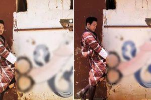 Lan truyền bức ảnh 'hoàng tử sơn ca' Quang Vinh tạo dáng phản cảm bên hình vẽ bộ phận sinh dục