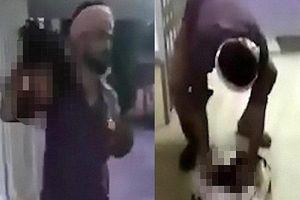 Ấn Độ: Rợn người clip người đàn ông mang đầu vợ tới đồn cảnh sát tự thú