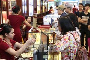 Vàng và tỷ giá USD cùng bật tăng trong phiên giao dịch cuối tuần
