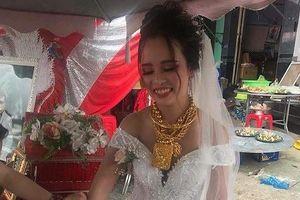 'Hotgirl' Hậu Giang đeo 129 cây vàng trong ngày cưới gây sốc