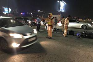 TP.HCM: Va chạm với xe tải, đôi nam nữ tử vong trên cầu Sài Gòn