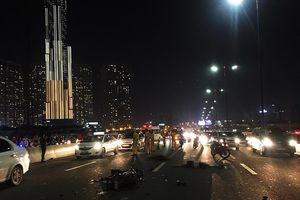 Chạy xe vào làn đường ôtô, đôi nam nữ chết thảm trên cầu Sài Gòn