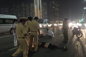 Đâm vào xe tải, đôi nam nữ chết thảm trên cầu Sài Gòn
