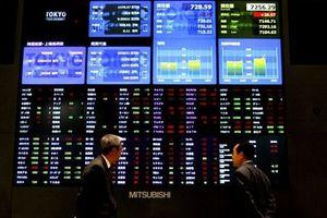Chứng khoán Châu Á biến động sau khi Mỹ nâng lãi suất lần thứ 3 trong năm