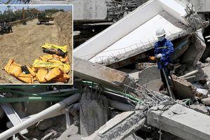 Đào mộ tập thể 10x100m chôn cất sớm những thi thể sau thảm họa ở Indonesia