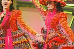 Đông Nhi mặc váy người H'mông, đội nón lá đến Nhật Bản giao lưu