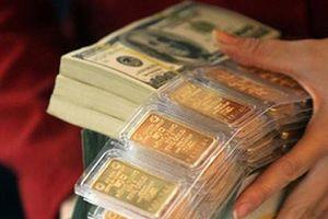 Giá vàng 'loạn nhịp', USD hạ nhiệt