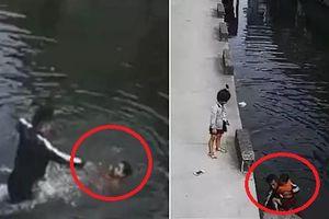 Clip: Nhân viên giao hàng nhảy sông cứu bé gái vùng vẫy trong nước