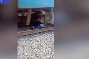 Hãi hùng pha thoát thân dưới gầm tàu hỏa như phim hành động