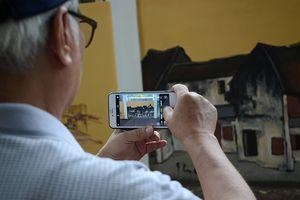 Hà Nội xưa được tái hiện qua tranh bích họa trên phố Phan Đình Phùng