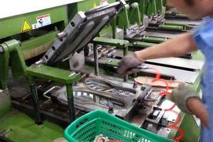 Doanh nghiệp ngành dệt may, da giày và áp lực tồn tại