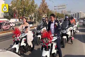 Cô dâu lái mô tô phân khối lớn dẫn đầu đoàn xe cưới khiến cư dân mạng thích thú