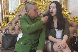 Thực hư ảnh Dương Minh Tuyền bầm mắt chĩa súng vào nữ tiếp viên karaoke