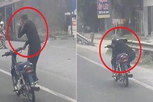 Nam thanh niên gây náo loạn trên đường khi vừa lái xe bằng một tay vừa 'diễn xiếc'