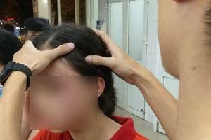 Điều tra vụ cháu bé 14 tuổi nghi bị mẹ kế đánh nhập viện