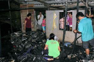 Bé gái bại liệt tử vong thương tâm trong căn nhà cháy