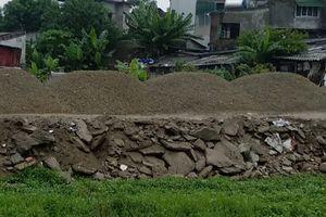 Vụ làm đường bằng rác thải xây dựng:UBND TP.Vinh xin lùi thời hạn xử lý