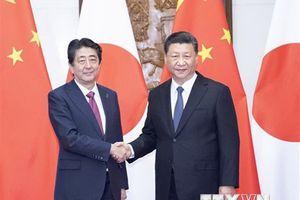 Thủ tướng Nhật Bản có các cuộc trao đổi ngắn với lãnh đạo Trung-Hàn
