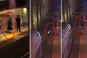 Nhảy xuống đường ray hòng dọa bạn trai, cô gái gặp phen hú vía khi tàu lao tới