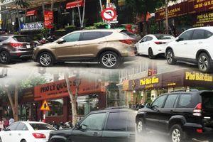 Vì sao không dẹp được nạn dừng đỗ xe ở đường Võ Chí Công?