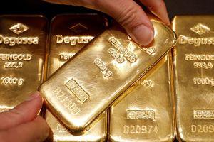 Giá vàng tăng, USD giảm sau tuyên bố 'mềm mỏng' của Chủ tịch FED
